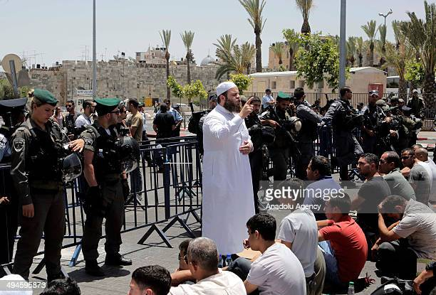 Hundreds of Palestinian youths perform Friday prayers on the streets outside the AlAqsa Mosque compound after Israeli police barred under 45 years...