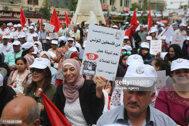Hundreds of Palestinians gather to demonstration demanding the improvement of working conditions on the occasion of the International Workers' Day...