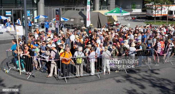 Hundreds of participants wait in front of the train station in Berlin Suedkreuz for the transport to the final mass of the Kirchentag festival in...