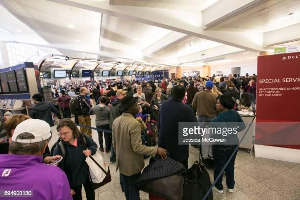 Hundreds of passengers wait in Delta ticketing lines at HartsfieldJackson Atlanta International Airport on December 18 2017 in Atlanta Georgia...