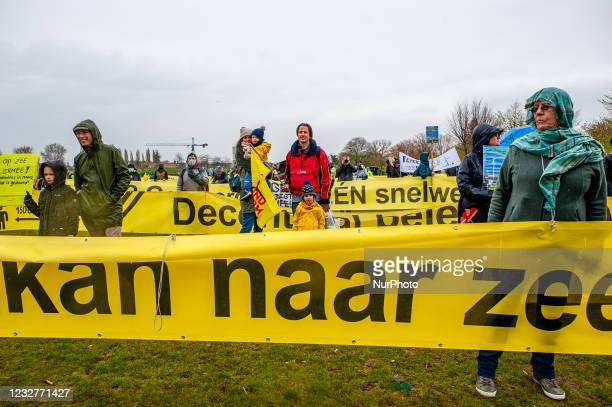 Hundreds of people are holding huge banners and placards, during the national demonstration against wind turbines near homes and in nature reserves...