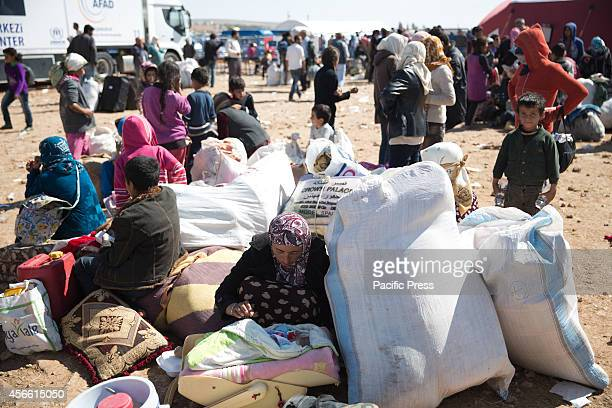 Hundreds of people are waiting for an opportunity to pass border in Kobane district from Sanliurfa Turkey where thousands of refugees passed across...