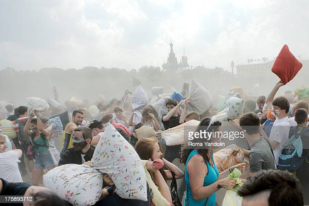 CONTENT] Hundreds of people armed with pillows take part in the traditional Pillow Battle in the historical center of St Petersburg Russia June 29...