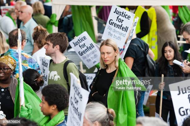 Hundreds of people assemble outside Downing Street in central London for a protest march to the Home Office a year after the Grenfell Tower fire...