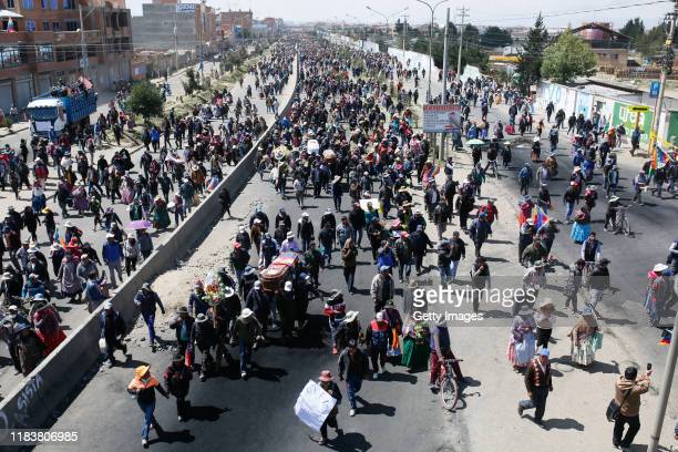 Hundreds of people attend the funeral of the men killed during clashes with police at the Senkata fuel plant on November 21 2019 in El Alto the...