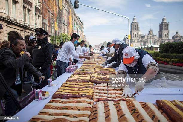 Hundreds of people attends the giant Three Kings bread celebration at the Capital Square on January 03, 2013 in the Mexico City, Mexico. The gigant...
