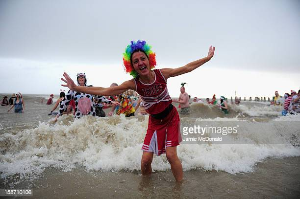 Hundreds of people brave the North Sea to raise money for charity during the annual Christmas Day dip at Lowestoft Beach on December 25 2012 in...