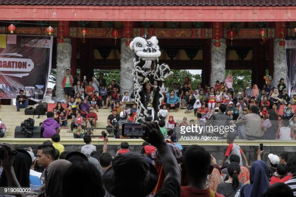 Hundreds of people come to watch a Lion Dance show as a part of Lunar New Year celebration in the Sam Poo Kong temple in Semarang Central Java...