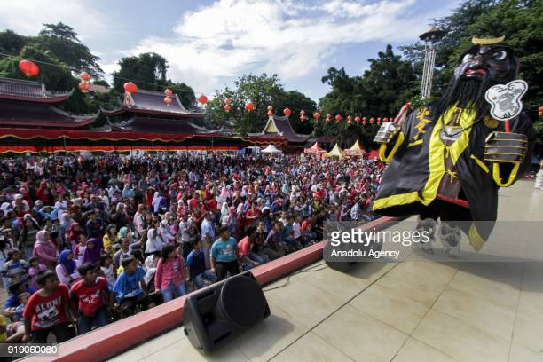 Hundreds of people come to watch a puppet show as a part of Lunar New Year celebration in the Sam Poo Kong temple in Semarang Central Java Indonesia...