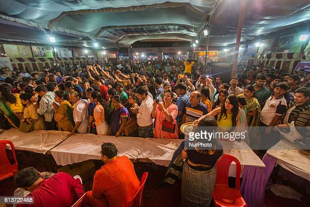 Hundreds of people come together to offer their prayers to the Hindu Goddess Durga in one of the Puja Pandals on the eighth day of the Dussehra...