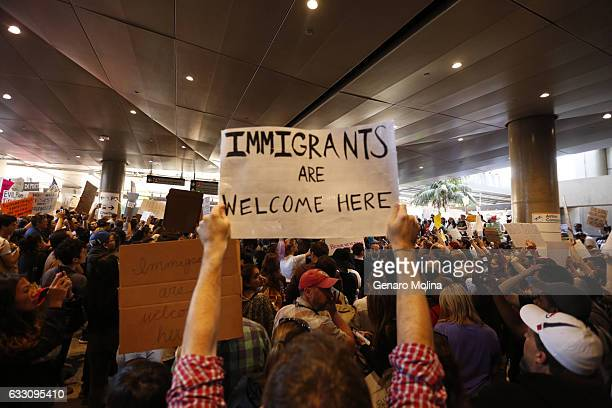 Hundreds of people continue to protest President Donald Trump's travel ban at the Tom Bradley International Terminal at LAX on January 29 2017 in Los...