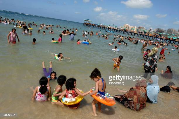 Hundreds of people crowd Miami Beach in Alexandria Egypt on Sunday Aug 12 2007 'In Egypt you are where you swim' says Mohammed Awad an historian and...