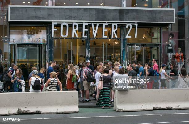 Hundreds of people crowd the sidewalk in front of Forever 21 in Times Square on June 10, 2017 in New York, New York. With a full schedule of...