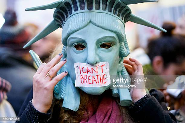 Hundreds of people demonstrate at White City Westfield Shopping Centre in London England on December 10 2014 during a protest after two grand juries...