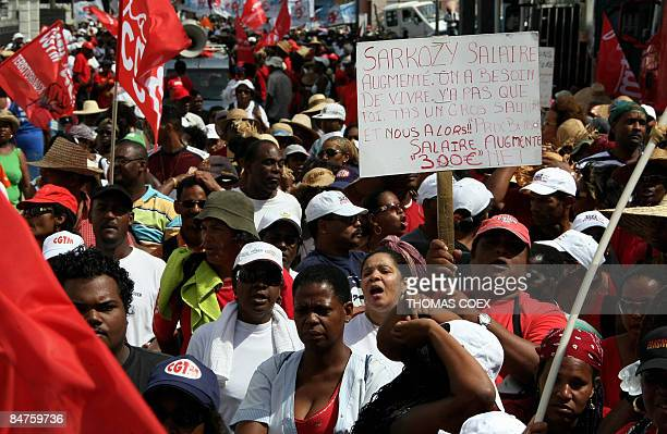 Hundreds of people demonstrate in FortdeFrance in the overseas island of Martinique on February 12 2009 as French Overseas State Secretary Yves jego...