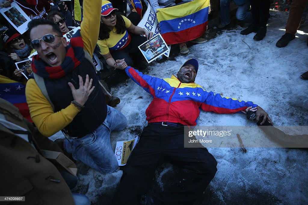 Hundreds of people demonstrate in support of the Venezuelan opposition during a protest in Union Square on February 22, 2014 in New York City. Opposition protests and a government crackdown in Venezuela have thown the country into turmoil in the last week.
