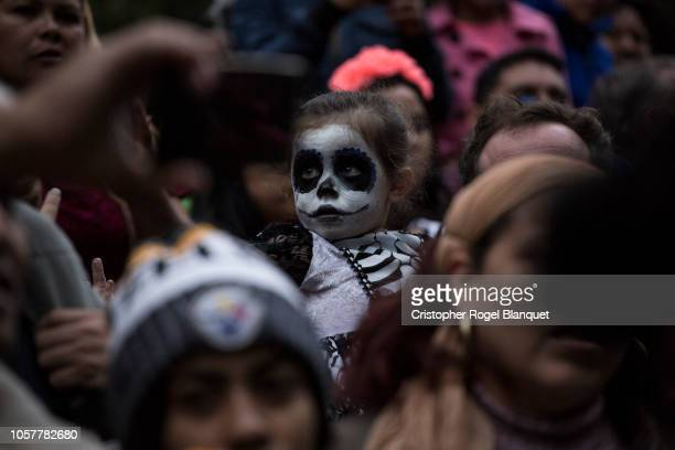 Hundreds of people dressed as Catrinas walk through Paseo de la Reforma the most important avenue in Mexico City on October 21 2018 in Mexico City...