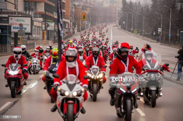 Hundreds of people dressed as Santa Claus are seen during a Christmas ride on December 19, 2020 in Sofia, Bulgaria. The Christmas Ride is an annual...