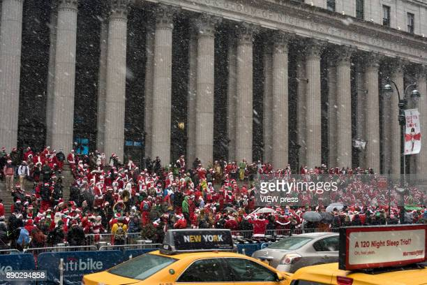 Hundreds of people dressed as Santas gather at Post Office steps in Manhattan to celebrate the annual Santacon event in December 9 2017 in New York...