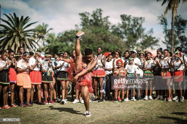 Hundreds of people dressed in traditional attire sing and chant in Durban take part on May 26 2018 in a street carnival festival celebrating Africa...