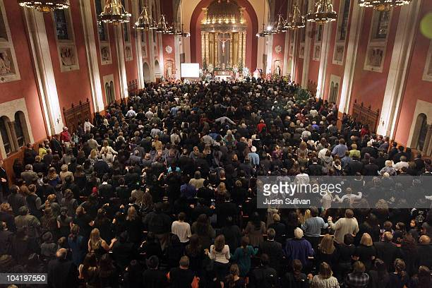 Hundreds of people fill Saint Cecilia Catholic Church for a memorial service for San Bruno fire victims Jacqueline Greig and her daughter Janessa on...
