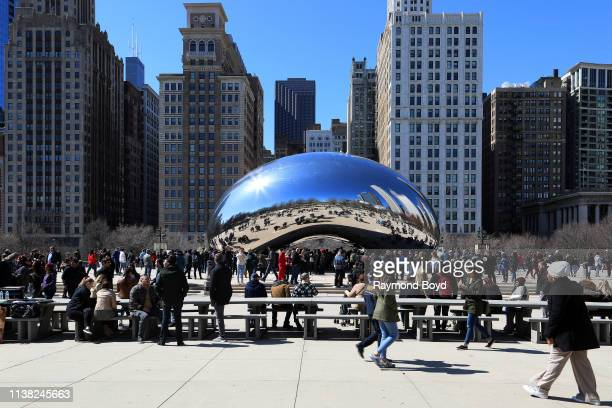 Hundreds of people flock to Anish Kapoor's 'Cloud Gate' sculpture in Millennium Park in Chicago Illinois on March 23 2019 MANDATORY MENTION OF THE...