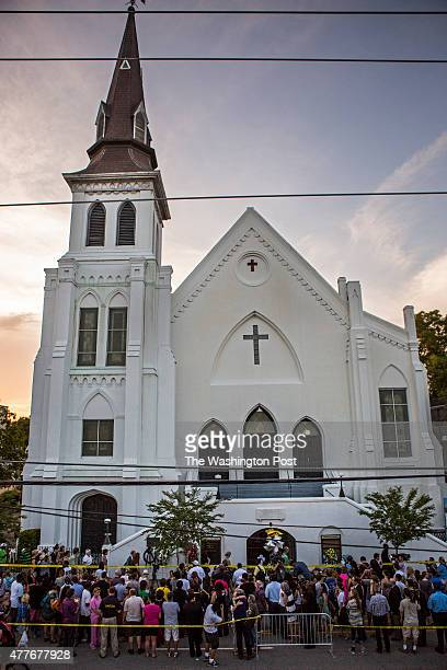 Charleston SC JUNE Hundreds of people from all over stream past Emanuel AME Church to pay their respects and show support for the community