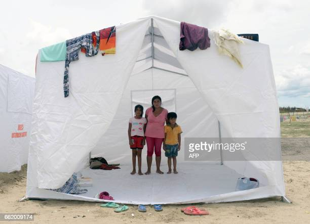 TOPSHOT Hundreds of people from small villages close to the city of Piura in northern Peru are gathering in temporary camps on March 31 where they...