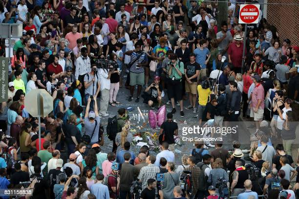 Hundreds of people gather at an informal memorial on the spot where 32yearold Heather Heyer was killed when a car plowed into a crowd of people...