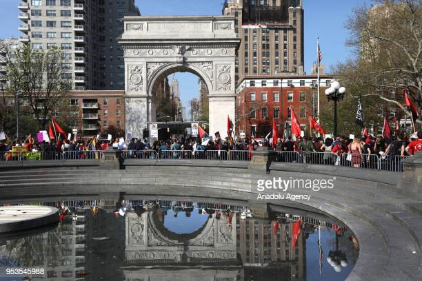 Hundreds of people gather at Union Square and march to Washington Square Park to mark the May Day International Workers' Day in New York United...