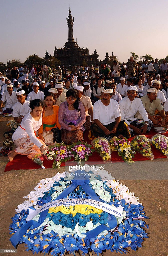 Hundreds of people gather during a memorial service for the victims of the bombing in a nightclub October 21, 2002 in Denpasar Bali, Indonesia. The blast occurred in the popular tourist area of Kuta October 12, leaving more than 180 people dead and 132 injured, mostly tourists.