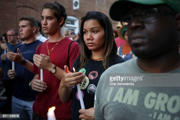 Hundreds of people gather for a candlelight vigil on the spot where 32yearold Heather Heyer was killed when a car plowed into a crowd of people...