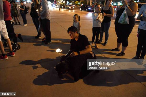 Hundreds of people gather for a vigil on the Las Vegas strip, for the victims of the Route 91 Harvest country music festival shootings on October 2,...