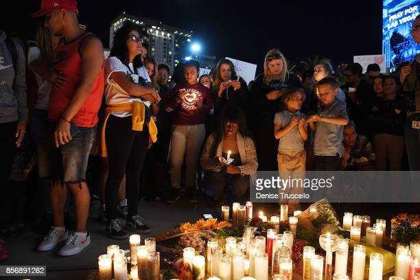 Hundreds of people gather for a vigil on the Las Vegas strip for the victims of the Route 91 Harvest country music festival shootings on October 2...