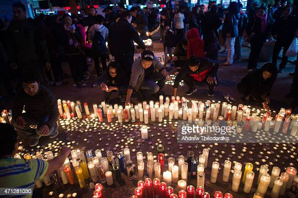 Hundreds of people gather in Diversity Square to light candles during a vigil for the victims of the earthquake in Nepal on April 26, 2015 in the...