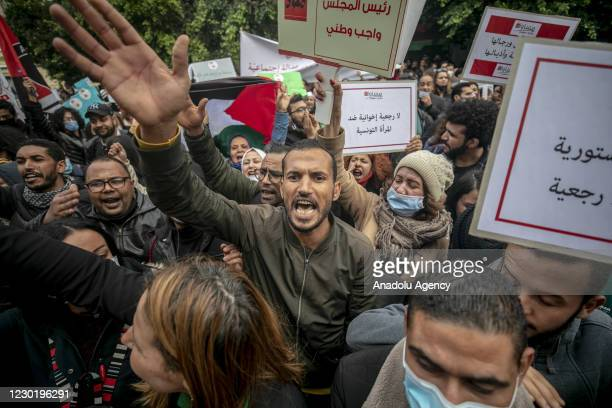 Hundreds of people gather in front of parliament building during a demonstration to protest against the attacks against some of the MPs and to...
