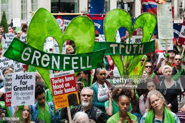 Hundreds of people gather outside the Home Office in central London as they take part in a protest march a year after the Grenfell Tower fire which...