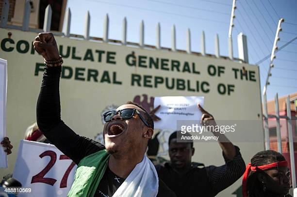 Hundreds of people gather outside the Nigerian Consulate in Rivonia Johannesburg on May 8 2014 during a protest against the Nigerian government's...