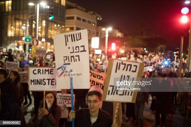 Hundreds of people gather to protest Israeli Prime Minister Benjamin Netanyahu over alleged corruption at the Habima Square in TelAviv Israel on...