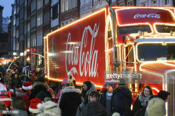 Hundreds of people gather to see the Christmas Coca Cola truck in Gdansk Poland on 6 December 2017 Freightliner FLD Conventional truck is 165 m long...