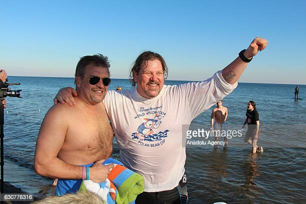 Hundreds of people gather to take part in a Toronto Polar Bear Dip organization held in Toronto Canada on January 01 2017 People volunteered for a...
