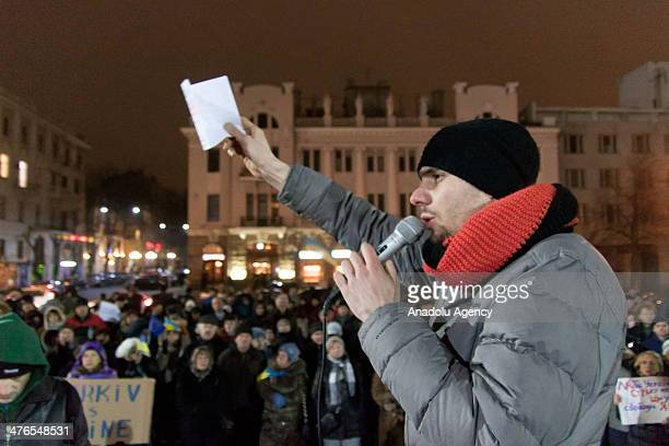 Hundreds of people gathered near the statue of Ukrainian poet Taras Hryhorovych Shevchenko attend a rally against Russia on March 3 2014 in Kharkov...
