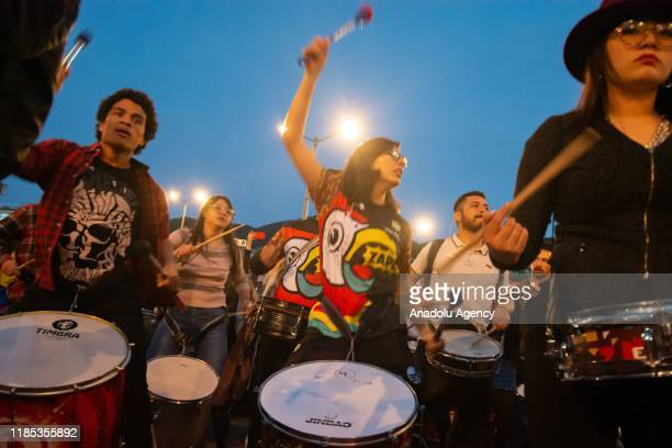 Hundreds of people gathered to participate and enjoy a percussion show or batucada organized by different musical groups in Bogota Colombia on...