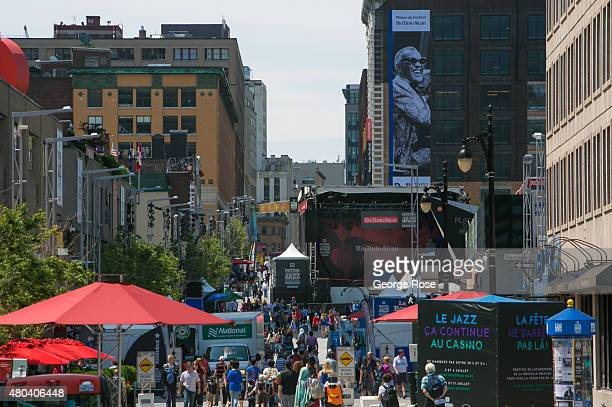 Hundreds of people head to the Montreal Jazz Festival in the Place des Arts plaza located on SainteCatherine Street in downtown on June 30 2015 in...