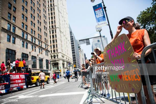 Hundreds of people including police, firefighters, hospitals and other frontline workers participate in a ticker tape parade to honor workers who...