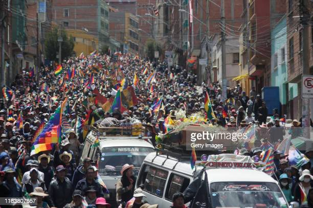 Hundreds of people join a funeral procession for the men killed during clashes with police at the Senkata fuel plant on November 21 2019 in La Paz...