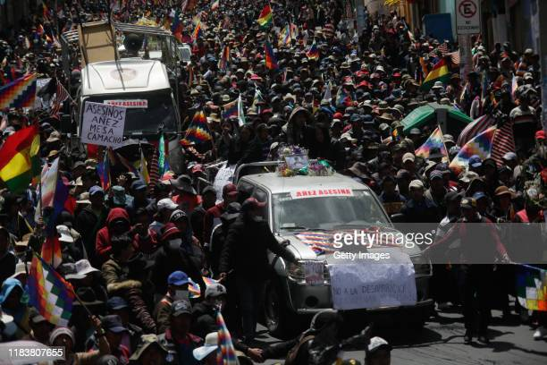 Hundreds of people join a funeral procession for the victims killed during clashes with police at the Senkata fuel plant on November 21 2019 in La...