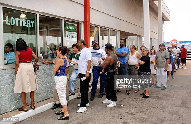 Hundreds of people line up to purchase Powerball lottery tickets 24 August 2001 at a gas station in Hammond Indiana located across the stateline from...