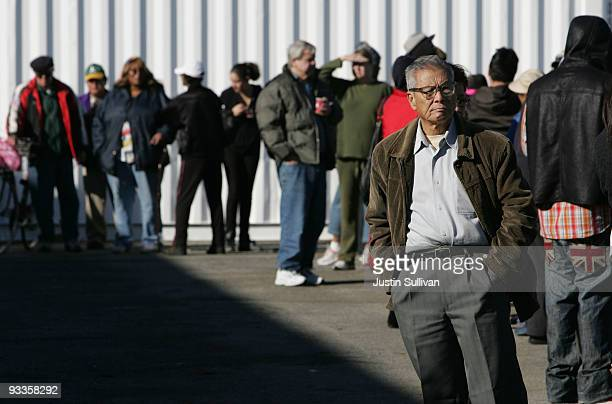 Hundreds of people line up to receive a Thanksgiving turkey November 24 2009 at the Alameda Food Bank in Alameda California Hundreds of needy people...