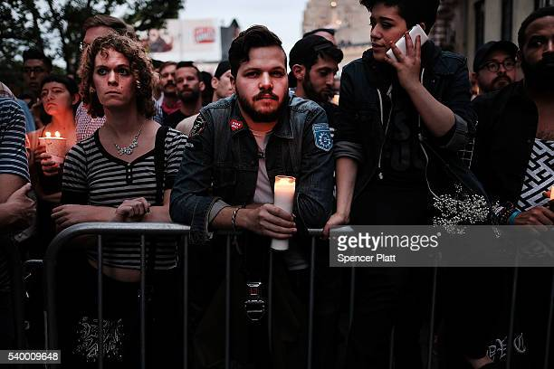 Hundreds of people listen to speakers at a memorial gathering for those killed in Orlando in front of the iconic New York City gay and lesbian bar...